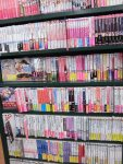 Many light novel publishers have a specific color for their spines to make their series easy to find.